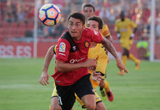 Real Mallorca against Girona soccer match playgame. Real Mallorca player Moutinho and Girona Camara fight for the ball during their second division soccer league Royalty Free Stock Photography