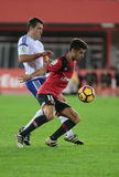 Real Mallorca against Real Zaragoza soccer league match at iberostar stadium in Mallorca. Mallorca Soccer player controls the ball against Zaragoza player Stock Photo