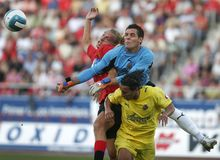 Real Mallorca against Villareal gameplay. Real Mallorca Maxi Lopez collides with Villareal goalkeeper and defense during their first division soccer game in Royalty Free Stock Photography