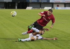 Real Mallorca soccer match gameplay. Real Mallorca player Moutinho and unidentified Real zaragoza player fight for the ball during their second division soccer Royalty Free Stock Images