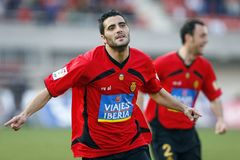 Dani Guiza celebration after scoring a goal. Real Mallorca striker Dani Guiza gestures aftyer scoring a goal during his league match in mallorca Royalty Free Stock Photos
