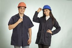 Detail of real mechanic man and woman stock photo