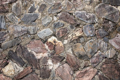 Real medieval stone wall surface can use as background pattern or texture with real light at old town Songkhla Thailand. (vintage style Royalty Free Stock Image