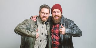 Real men and brotherhood. Friends glad see each other. Friendly relations. Friendship of brutal guys. Real friendship. Mature friends. Male friendship concept royalty free stock photography