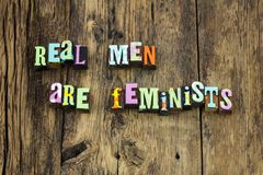 Real men feminist male gender letterpress. Real men feminist male gender typography letterpress feminism man woman female gentle help power social right rights stock images