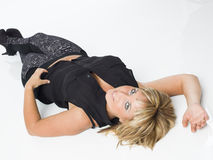 Real middle aged woman laying on white floor Royalty Free Stock Images