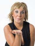 Real middle aged woman posing on white background Stock Photos