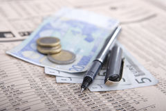 Real money over financial newspaper Royalty Free Stock Photography