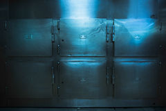 Real morgue trays in a low key photo. Grungy and high contrast photo of morgue trays Royalty Free Stock Image