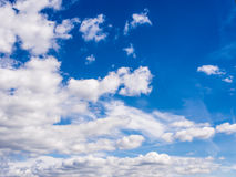 Real natural cloudy blue sky. Suitable as weather nature meteorology heaven illustration or beautiful peaceful background Stock Images