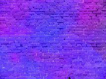 Real neon light on the brick wall royalty free stock photography