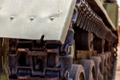Real old heavy tracked tank and front roller. close up. steampunk detail background. Real old heavy tracked tank and front roller close up. tank front with wing stock photo