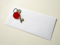 Real old key on real envelope on real cream color table with rea Stock Images