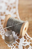 Real old reels spoons treads with needle and thimble Royalty Free Stock Photography