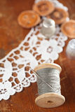 Real old reels spoons treads with needle and thimble Royalty Free Stock Photo