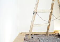Free Real Old Wooden Ladder Of A Painter In Use For An Interior Renovation. Painter Cover Fleece For Protection Of Floor Surfaces. Royalty Free Stock Image - 183160846