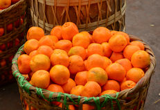Real organic oranges at market stall Stock Photo