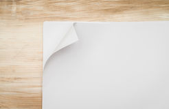 Real Paper Corner Fold on wood background. Royalty Free Stock Images