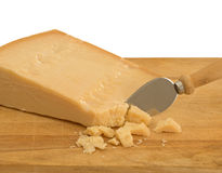 Real Parmesan cheese with knife on old cheese board Stock Photos