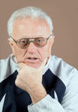 Real people portrait. Close up photo of 75-s year old senior man looking at camera. It is not isolated Stock Photo