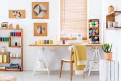 Colorful room interior with a desk, sewing machine and threads
