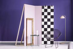 Real photo of a creative arrangement of furniture in purple inte Stock Image