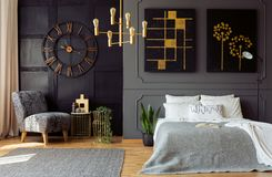 Dark grey bedroom interior with molding and painti stock image