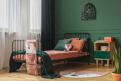 Free Real Photo Of A Rug Shaped Like A Fox On The Wooden Floor Of A Child`s Bedroom Interior With Orange Sheets And Pillows On A Black Royalty Free Stock Photos - 149370448