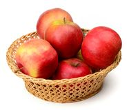 Apples in basket. Real photo of red shiny apples in a basket on a white neutral background Royalty Free Stock Images