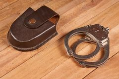 Real police handcuffs stock photography