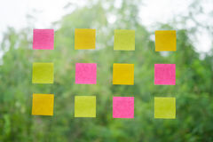 real post it notes to share idea and brainstorming concept. Stock Image