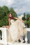Real princess. In white-golden gown sits on banisters its palace Stock Images