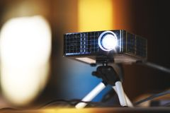 Real projector at business conference or presentation in the off royalty free stock photo