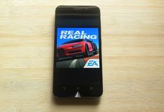Real Racing 3 game. App on smartphone kept on wooden table stock photos