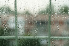 Real rain drops on window glass in high resolution. Backdrop Stock Photos