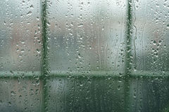 Real rain drops on window glass in high resolution. Backdrop Royalty Free Stock Image
