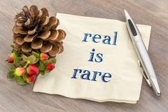 Real is rare reminder on napkin royalty free stock image