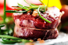 Real Raw fresh meat Steak filet mignon and rosemary Royalty Free Stock Images