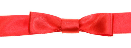 Real red bow knot on wide satin ribbon isolated Stock Photo