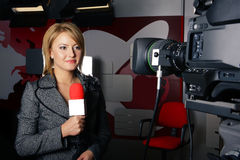 Real reporter with braking news smiling Royalty Free Stock Image