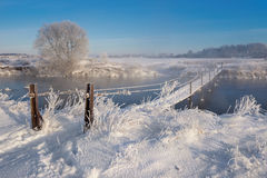 Real Russian Winter. Winter Landscape With Trail Across The  Dangerous Rural Suspension Bridge Over The Snowy Foggy River Stock Images