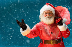 Real Santa Claus, carrying big bag full of gifts to children Royalty Free Stock Image