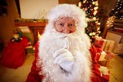 Real Santa Claus gesturing shhh stock photography