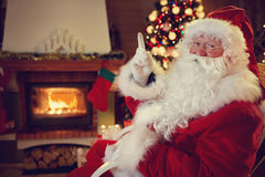 Real Santa Claus threaten children to be obedient. Gesture with finger stock images