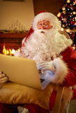 Real Santa Claus using laptop to communicating with children stock photos