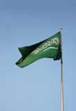 Real Saudi Arabia flag waves in the pole. Photo of real saudi arabiann flag image flies over a sky stock photo