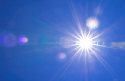 Real Shining sun at clear blue sky. Real Shining sun flare at clear blue sky Stock Photos