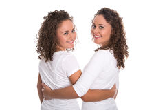 Real similar twins with natural stop curls isolated over white b Royalty Free Stock Images