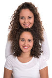 Real similar twins with natural stop curls isolated over white b Stock Photo