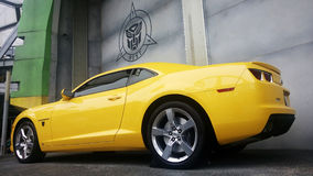 Real Size Yellow Chevrolet Camaro Car. SINGAPORE, JUN 04, 2016: Real Size Yellow Chevrolet Camaro Car or Bumblebee Robot in Transformer Movie Royalty Free Stock Photography